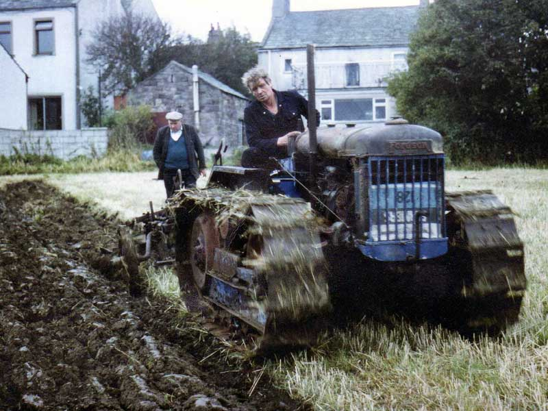 Alan Mattocks, founder member and former chairman ploughing with his E27N Crawler in the museum field.