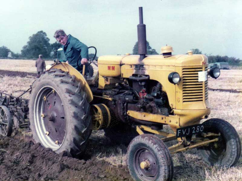 Alan Mattocks at Seaton Working day ploughing with Syd's Minneapolis Moline UTS